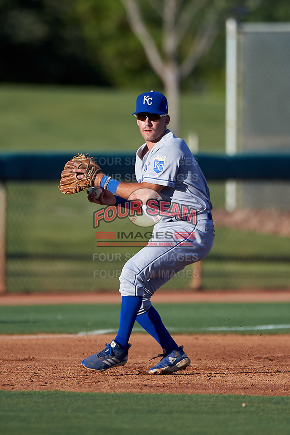 AZL Royals third baseman Jimmy Govern (8) throws to first base during an Arizona League game against the AZL White Sox at Camelback Ranch on June 19, 2019 in Glendale, Arizona. AZL White Sox defeated AZL Royals 4-2. (Zachary Lucy/Four Seam Images)