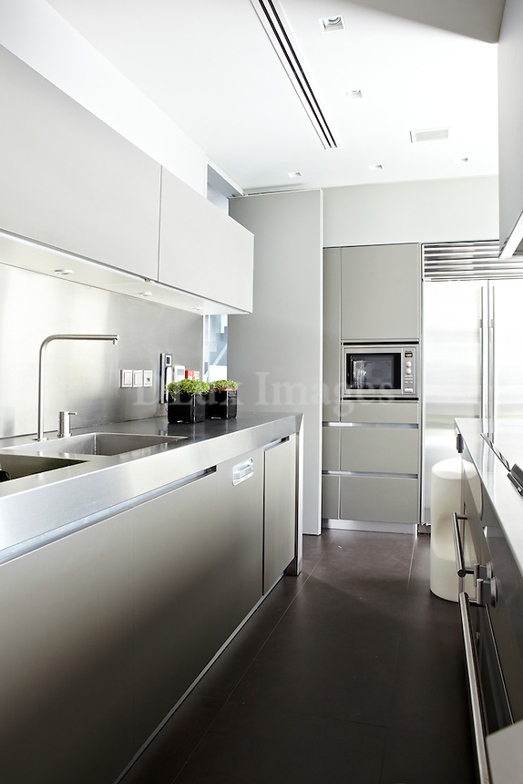 contemporary inox kitchen<br /> <br /> George Efthimiou designed Tsokouloglou's villa in Filothei, a suburb of Athens, Greece. This newly built 600 square meter house has 4 levels, ten rooms, a big garden and a luxury swimming pool.