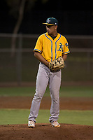 AZL Athletics relief pitcher Jorge Martinez (51) prepares to deliver a pitch during an Arizona League game against the AZL Giants Black at the San Francisco Giants Training Complex on June 19, 2018 in Scottsdale, Arizona. AZL Athletics defeated AZL Giants Black 8-3. (Zachary Lucy/Four Seam Images)