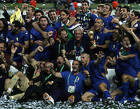 The Italian team shows off the trophy after the game.  Italy defeated France on penalty kicks after leaving the score tied, 1-1, in regulation time in the FIFA World Cup final match at Olympic Stadium in Berlin, Germany, July 9, 2006.