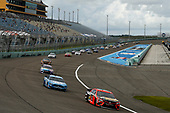 HOMESTEAD, FLORIDA - JUNE 14: Martin Truex Jr., driver of the #19 Toyota, leads a pack of cars during the NASCAR Cup Series Dixie Vodka 400 at Homestead-Miami Speedway on June 14, 2020 in Homestead, Florida. (Photo by Michael Reaves/Getty Images)