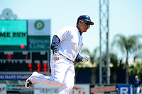 Detroit Tigers third baseman Miguel Cabrera #24 rounds third on a Prince Fielder (not shown) home run during a Spring Training game against the Tampa Bay Rays at Joker Marchant Stadium on March 29, 2013 in Lakeland, Florida.  (Mike Janes/Four Seam Images)