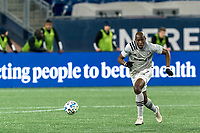FOXBOROUGH, MA - NOVEMBER 20: Rod Fanni #7 of Montreal Impact brings the ball forward during the Audi 2020 MLS Cup Playoffs, Eastern Conference Play-In Round game between Montreal Impact and New England Revolution at Gillette Stadium on November 20, 2020 in Foxborough, Massachusetts.