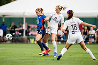 TACOMA, WA - JULY 31: Eugenie Le Sommer #9 of the OL Reign and Gemma Bonner #4 of Racing Louisville FC battle for the ball during a game between Racing Louisville FC and OL Reign at Cheney Stadium on July 31, 2021 in Tacoma, Washington.