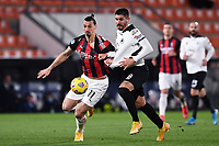 Zlatan Ibrahimovic of AC Milan and Martin Erlic of Spezia Calcio compete for the ball during the Serie A football match between Spezia Calcio and AC Milan at Spezia stadium in Spezia (Italy), February 13th, 2021. Photo Image Sport / Insidefoto
