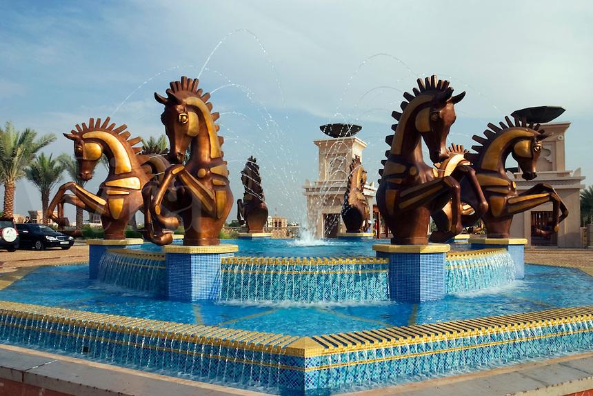 Dubai, United Arab Emirates. Al Qasr Hotel.  Fountain in front of the main entrance to the hotel..