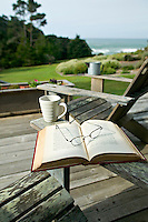 A serene morning with a book and coffee on the deck of a home overlooking the Pacific Ocean