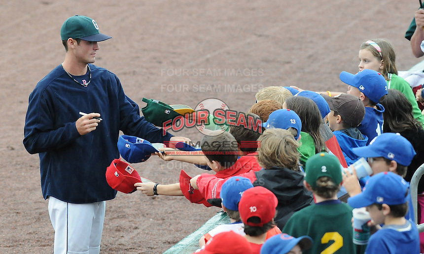 May 17, 2009: A Greenville Drive player signs autographs during a rain delay prior to a scheduled game between the Greenville Drive and Rome Braves at Fluor Field at the West End in Greenville, S.C. The game eventually was postponed. Photo by: Tom Priddy/Four Seam Images