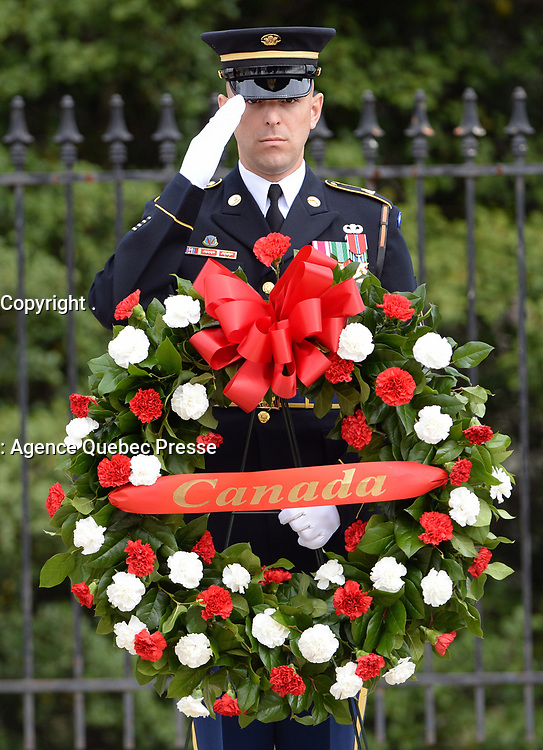 With full Ceremonial Honors presented, A member of the Honor Guard at Arlington National Cemetery, Arlington, Virginia, pays his respects during the wreath laying ceremony at the Tomb of the Unknowns in honor of the Prime Minister's official visit to the United States. (Department of Defense photo by Marvin Lynchard)