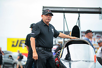 Aug 31, 2019; Clermont, IN, USA; Mike Salinas stands alongside the car of NHRA top alcohol dragster driver Jasmine Salinas during qualifying for the US Nationals at Lucas Oil Raceway. Mandatory Credit: Mark J. Rebilas-USA TODAY Sports