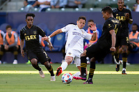 CARSON, CA - MAY 8: Javier Hernandez #14 of the Los Angeles Galaxy reaches for a ball during a game between Los Angeles FC and Los Angeles Galaxy at Dignity Health Sports Park on May 8, 2021 in Carson, California.