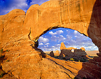 Turret Arch as seen through North Window. Arches National Park. Utah. Sky has been added.