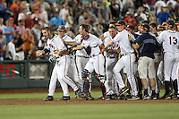 Mike Papi #38 of the Virginia Cavaliers celebrates his walk-off hit with teammates during Game 4 of the 2014 Men's College World Series between the Virginia Cavaliers and Ole Miss Rebels at TD Ameritrade Park on June 15, 2014 in Omaha, Nebraska. (Brace Hemmelgarn/Four Seam Images)