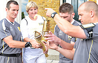 July 21, 2012: British Sign Language user Olive Lycett of Hackney, and members of the Olympic Torch team transfer the flame after ceremony at Clissold Park, Stoke Newington in London, England.