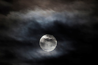 The Full Snow Moon, filtered through remnants of recent storms along California's coast.