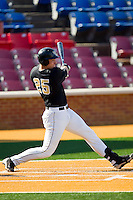 Matt Conway #25 of the Wake Forest Demon Deacons follows through on his swing against the Miami Hurricanes at Gene Hooks Field on March 19, 2011 in Winston-Salem, North Carolina.  The Hurricanes defeated the Demon Deacons 4-3.  Photo by Brian Westerholt / Four Seam Images