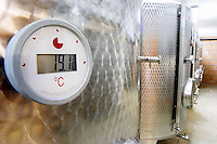 The winery with modern stainless steel fermentation tanks. Detail of tank thermometer showing 19.1 degrees centigrade. Make Letina. Toreta Vinarija Winery in Smokvica village on Korcula island. Vinarija Toreta Winery, Smokvica town. Peljesac peninsula. Dalmatian Coast, Croatia, Europe.