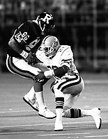 Don Wilson of the Edmonton Eskimos tackles Gerald Alphin Ottawa Rough Riders 1987. Photo Scott Grant