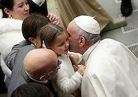 Papa Francesco bacia una bambina al termine dell'Udienza Generale del mercoledi' in aula Paolo VI, Citta' del Vaticano, 14 dicembre 2016.<br /> Pope Francis kisses a child at the end of his weekly general audience in Paul VI Hall at the Vatican, on December 14, 2016.<br /> UPDATE IMAGES PRESS/Isabella Bonotto<br /> <br /> STRICTLY ONLY FOR EDITORIAL USE
