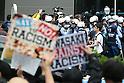 Kawasaki Police surround anti-foreign demonstrators