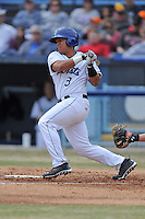 Asheville Tourists designated hitter Wilfredo Rodriguez #3 swings at a pitch during a game against the  Delmarva Shorebirds at McCormick Field on April 6, 2014 in Asheville, North Carolina. The Shorebirds defeated the Tourists 4-2. (Tony Farlow/Four Seam Images)