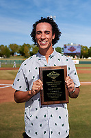Surprise Saguaros shortstop Cole Tucker (2), of the Pittsburgh Pirates organization, poses with the 2018 Dernell Stenson Sportsmanship Award plaque before the Arizona Fall League Championship Game against the Peoria Javelinas at Scottsdale Stadium on November 17, 2018 in Scottsdale, Arizona. (Zachary Lucy/Four Seam Images)