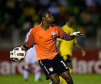Kendall McIntosh (18) of the United States looks for an open man to throw to during the semifinals of the CONCACAF Men's Under 17 Championship at Catherine Hall Stadium in Montego Bay, Jamaica. The United States defeated Jamaica, 2-0.
