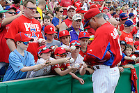 Philadelphia Phillies third base coach Ryne Sandberg #23 signs autographs before a Spring Training game against the Boston Red Sox at Bright House Field on March 24, 2013 in Clearwater, Florida.  Boston defeated Philadelphia 7-6.  (Mike Janes/Four Seam Images)