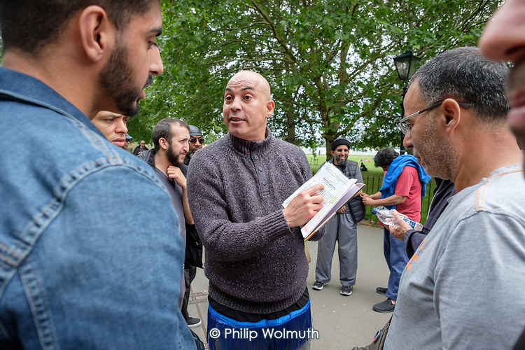 Christian preacher, with Bible, Speakers' Corner, Hyde Park, London.
