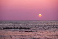 Canoe paddlers at sunset, Haleiwa, O'ahu.