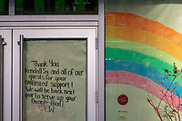 "Paper decorated with a rainbow and a handwritten note to customers cover the windows and front door of Commonwealth, a restaurant in Kendall Square in Cambridge, Massachusetts, on Mon., Jan. 4, 2021. The note on the door reads ""Thank you Kendall Sq. and all of our guests for your continued support! We will be back next year to serve up your favorite food! [Heart] CW."" In an interview with Boston Eater, Commonwealth owner Steve ""Nookie"" Postal talked about his decision to hibernate the restaurant in Sept. 2020, stating that it's not a closure: "" No. Hibernating, like a bear. 'Til when? 'Til this shit is over."""
