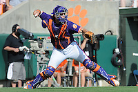 Catcher Spencer Kieboom #22 fields and throws during a  game against the Miami Hurricanes at Doug Kingsmore Stadium on March 31, 2012 in Clemson, South Carolina. The Tigers won the game 3-1. (Tony Farlow/Four Seam Images).