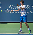 Vasek Pospisil (CAN) wins the second set against Roger Federer (SUI) at the Western & Southern Open in Mason, OH on August 13, 2014.