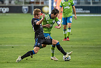 SAN JOSE, CA - OCTOBER 18: Jackson Yueill #14 of the San Jose Earthquakes and Nicolas Lodeiro #10 of the Seattle Sounders battle for the ball during a game between Seattle Sounders FC and San Jose Earthquakes at Earthquakes Stadium on October 18, 2020 in San Jose, California.
