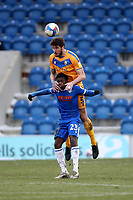 Ryan Sweeney of Mansfield Town and Kwame Poku of Colchester United during Colchester United vs Mansfield Town, Sky Bet EFL League 2 Football at the JobServe Community Stadium on 14th February 2021