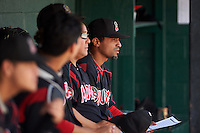 Batavia Muckdogs manager Angel Espada (4) watches the action during a game against the Auburn Doubledays on September 7, 2015 at Falcon Park in Auburn, New York.  Auburn defeated Batavia 11-10 in ten innings.  (Mike Janes/Four Seam Images)
