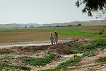 Two Berber men of the fields talk over the days news.
