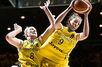 Melbourne, 15 August 2015 - Natalie BURTON of Australia jumps for the ball in game one of the 2015 FIBA Oceania Championships in women's basketball between the Australian Opals and the New Zealand Tall Ferns at Rod Laver Arena in Melbourne, Australia. Aus def NZ 61-41. (Photo Sydney Low / sydlow.com)