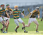 Donal Cronin of Glen Rovers in action against Cathal Doohan and Pearse Lillis of Ballyea during their Munster Club hurling final at Thurles. Photograph by John Kelly.