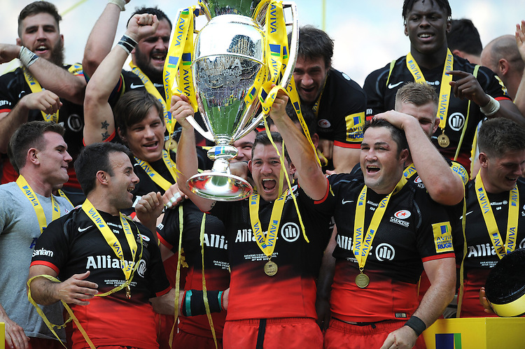 Alex Goode of Saracens lifts the trophy after winning the Aviva Premiership Rugby Final between Saracens and Exeter Chiefs at Twickenham Stadium on Saturday 28th May 2016 (Photo: Rob Munro/Stewart Communications)