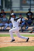 GCL Yankees East shortstop Borinquen Mendez (4) follows through on a swing during a game against the GCL Blue Jays on August 2, 2018 at Yankee Complex in Tampa, Florida.  GCL Yankees East defeated GCL Blue Jays 5-4.  (Mike Janes/Four Seam Images)