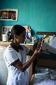 A nurse prepares to vaccinate children at the local health clinic in Eskdale Tea Estate in Nuwareliya in Central Sri Lanka.  Photo: Sanjit Das/Panos