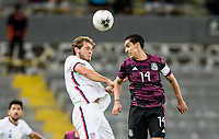GUADALAJARA, MEXICO - MARCH 24: Tanner Tessmann #11 of the United States and Erick Aguirre #14 of Mexico battle during a game between Mexico and USMNT U-23 at Estadio Jalisco on March 24, 2021 in Guadalajara, Mexico.