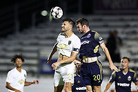 CARY, NC - AUGUST 01: Alex Crognale #21 and Conor Donovan #20 bump heads while challenging for a header during a game between Birmingham Legion FC and North Carolina FC at Sahlen's Stadium at WakeMed Soccer Park on August 01, 2020 in Cary, North Carolina.
