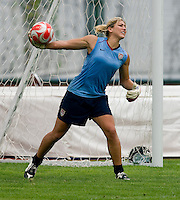 USWNT goalkeeper Hope Solo throws the ball out during practice at Beijing Normal University in preparation for the Olympic gold medal game at Workers' Stadium in Beijing, China.