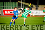 Tussle for possession between Ryan Kelliher of Killarney Celtic and Joe Rudden of Killarney Athletic in the Greyhound Bar Cup Final.