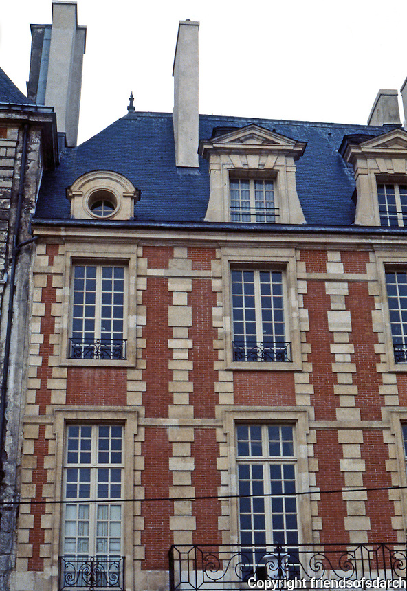 Paris: Place des Vosges. Restored upper story.