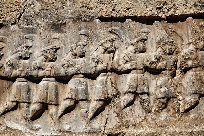 Close up of the sculpture of the twelve gods of the underworld from the 13th century BC Hittite religious rock carvings of Yazılıkaya Hittite rock sanctuary, chamber B,  Hattusa, Bogazale, Turkey.
