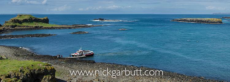 Turus Mara boat bringing tourists to see the sea bird colonies on the Isle of Lunga, Treshnish Isles, Isle of Mull, Scotland.