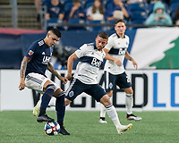 FOXBOROUGH, MA - JULY 18: Gustavo Bao #7 dribbles as Lucas Venuto #7 defends during a game between Vancouver Whitecaps and New England Revolution at Gillette Stadium on July 18, 2019 in Foxborough, Massachusetts.